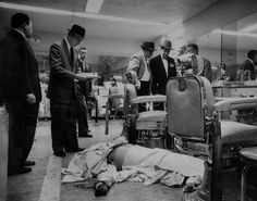 Albert Anastasia, 1957 Detectives take notes and examine the barbershop of New York's Park Sheraton Hotel, where the body of Murder Inc.'s Albert Anastasia lies, partially covered, on the floor after his murder by unknown gunmen. Albert Anastasia, Real Gangster, Mafia Gangster, Italian Mobsters, Mafia Crime, Al Capone, Gangsters, New York, History