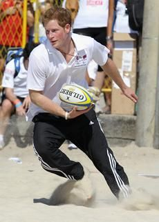 Prince Harry playing rugby