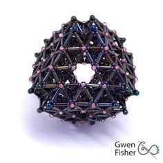 This large beaded bead is composted of 48 tetrahedron and 36 octahedrons, all arranged into a large octahedral form. It has 8 large triangular holes and is very hollow. The design is based upon the wo