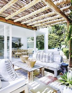 I love this pergola with sticks on top