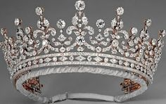 The Girls of Great Britain and Ireland Tiara    given to the future Queen Mary as a wedding present in 1893. The diamond tiara was purchased from Garrard, the London jeweller, by a committee organised by Lady Eve Greville. In 1947, Mary gave the tiara to her granddaughter, the future Queen Elizabeth II, as a wedding present.