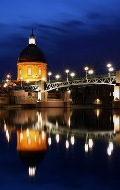 Gravely Blue,Toulouse,France.The dome of Hopital de St-Joseph de la Grave and Pont St Pierre above the Garonne River in Toulouse after the sun has gone down.The Hopital de St-Joseph de la Grave stands in St Cyprien, on the west bank of the Garonne River in Toulouse.It is one of a number of hospitals in the district,which sat within the city walls but on the other side of the river from the main settlement of Toulouse.