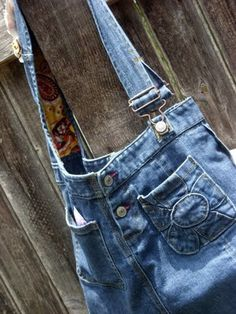 Cute!  Made from a denim jumper.  I could totally rock this as a purse, right?  Right?  Well, maybe Hannah could ;)