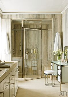 The master bath of a New York apartment by Delphine Krakoff is sheathed in silver travertine.
