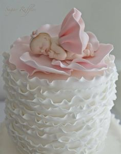 Pink ruffle  and sleeping baby shower cake ~ gorgeous!