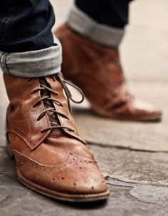 Worn-in wingtip boots.