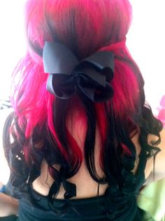 Pink hair with black dip-dye curls. Gorgeous!