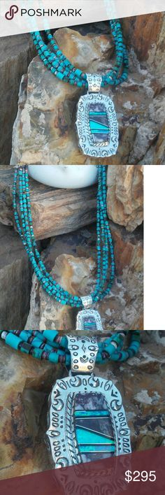 "Navajo Turquoise necklace Gorgeous 4 strands of blue turquoise and heishi beaded together with a beautiful sterling silver pendant made with opal and wild horse stone...marked sterling by artist Sandoval...hangs 20"" in length Jewelry Necklaces"