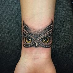 If you enjoy tattoos, you might look at an owl tattoo which might not be one of the known common tattoos, yet it's popular. They are gener. Owl Eye Tattoo, Owl Tattoo Small, Small Wrist Tattoos, Owl Tattoo Wrist, Tattoo Bird, Wrist Coverup Tattoos, Wrist Tattoo Cover Up, Cover Up Tattoos, Body Art Tattoos
