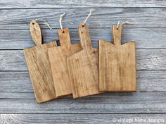 Mini Artisan Bread Boards - Set of 4 from Etsy    These boards are made from repurposed maple cabinet scraps and sealed with organic FDA approved raw tung oil and are 100% food safe. Each piece has been hand sanded with care to achieve a vintage, passed down from generation to generation aged look. $35 - would probably want a larger one rather than 4 mini ones.