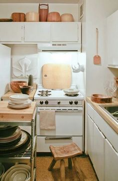 Tiny kitchen - for basement remodel  I like the cohesiveness of the white, wood and copper