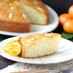Sweet oranges and fruity olive oil lend a fragrant aroma and moist crumb to this Italian-inspired Orange Almond Olive Oil cake. Cake Land, 9 Inch Cake Pan, Eggplant Salad, Spiced Cauliflower, Candied Orange Peel, Olive Oil Cake, Orange Recipes, Almond, Roast