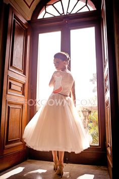 Dress yourself in this classic style wedding dress in your bid day! This simple tea length and A-line silhouette flatters effortlessly over any figure and also will make you decent in most special occasions. It comes with a lace bodice and tulle bottom, with a brown sash defining the waist.