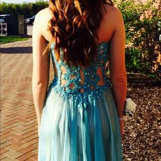 """La Femme 2015 Prom/Bridesmaid/Pageant Dress 2014 La Femme Dress! Only worn once. Gorgeous turquoise blue with cutouts (covered in mesh). Beaded bodice with double layered skirt. Originally $600! I am 5'4.5"""" and wore 4.5"""" heels to prom. The dress was hemmed to brush the floor. About 1.5"""" from the hem there are two holes (my heels got stuck and ripped though). However if you will be less than 5' 7"""" including heels then this dress will be perfect once u get it hemmed! PERFECT FOR PROM, PAGEANTS…"""