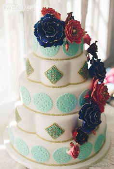 Love the Bold flowers and the design of the cake; not a fan of the varied teal and green - WedLuxe Magazine