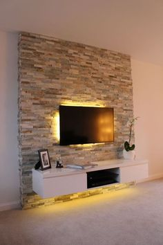 ▷ 1001 + Ideen für Fernsehwand Gestaltungen - Ideen und Tipps tv wall panel stone effects on the wall seinwand stones behind the television subtle led lighting in yellow color shelf under the televisi Dulux Feature Wall, Feature Wall Living Room, Living Room Tv, Feature Walls, Tv Wall Ideas Living Room, Stone Wall Living Room, Tv Wall Design, Design Case, House Design