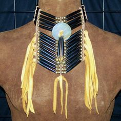Native American Four Strand Hairpipe Choker with mother of pearl center disc. $119