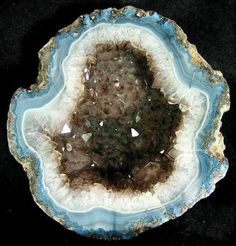 An unusually shaped coconut type #geode from Chihuahua, Mexico. Has nice blue and white fortifications surrounding a smoky-quartz center.  Dardilrocks on Flickr