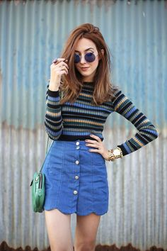 Casual outfit with a super cute scalloped skirt in denim and a classic striped…