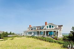 Porches and balconies lend a summery look to an East Quogue, New York, house devised by Robert A.M. Stern Architects and decorated by the design firm S. R. Gambrel | archdigest.com