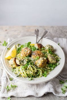 Chicken fetta kale meatballs on a bed of zoodles.
