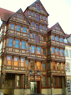 Germany - Hildesheim a beautiful half-timbered building. The façade is decorated with colorful paintings and German proverbs. Today the building houses a restaurant and the City Museum.