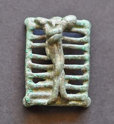 Intercourse between man and woman on bed, Amlash bronze figurine 30, belt buckle, 1st millenium B.C. Private collection