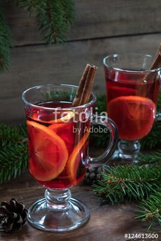 "Download the royalty-free photo ""Two glasses cup of delicious Christmas hot mulled wine with oranges and spices on wooden background"" created by Victoria Kondysenko at the lowest price on Fotolia.com. Browse our cheap image bank online to find the perfect stock photo for your marketing projects!"