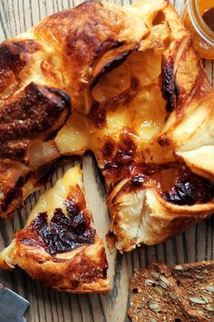 NYT Cooking: Serve a creamy, runny-centered, pastry-wrapped baked brie at your next party and watch your guests cluster around it, slicing off bits until it completely disappears. Don't be tempted to use a fancy, artisan brie from a cheese shop here. This recipe works best with the regular kind of brie you find at the supermarket