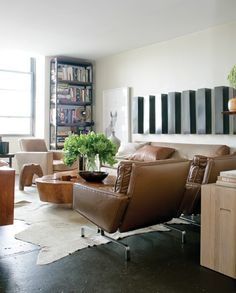 Soft Neutral Living Room- love the painted cement floor and the tree trunk coffee table