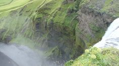 Looking over the edge of a waterfall - Iceland