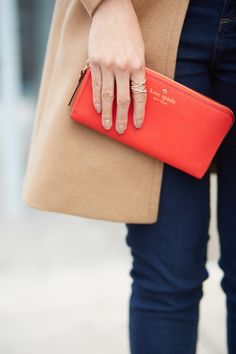 This red Kate Spade clutch is one of my favorite ways to accessorize an outfit that needs a little splash of color.