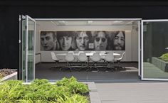 Conference room on the roof of one of E.E.C.'s many commercial properties across the city. Im loving the 'Evolution of John Lennon' art.  Photographed by www.sgmphotography.com