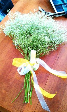 creative way to tell people you are pregnant - we took baby's breath and wrapped them with two pacifiers!!