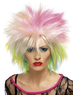 80er Jahre Punk Perücke bunt, aus unserer Kategorie Karnevalsperücken. Jede Punklady ist stolz auf ihre Frisur - wenn man so eine beeindruckende Mähne hat, kann man das auch definitiv sein! Großartiges Kostümzubehör für Fasching und 80er Jahre Mottopartys. #Karnevalskostüm #80erParty #Damenkostüm