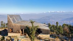 The roof structure of this house in the foothills of the Himalayas features a pointed peak incorporating skylights that allow daylight to flood in.