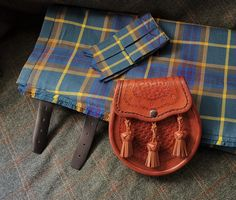 Created and Registered by us for the ARBUCKLE family. The day sporran in hand-tooled calf leather. By Afro-Celtic Sporrans in Cape Town, South Africa. Kilt Hire, Traditional Jacket, Tartan Tie, Leather Pieces, Kilts, Cape Town, Beautiful Hands, Calf Leather, Afro