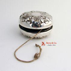 """Sterling silver Art Deco style yo-yo toy by Gorham Silversmiths; monogrammed """"JMA""""."""