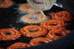A street vendor pipes batter into a wok full of hot oil to make jalebi, a sweet, crispy delight which will later be dipped in sugar syrup. Deserts Of The World, Street Vendor, Food Photography Styling, Onion Rings, Wok, Street Food, Pipes, Syrup, Ethnic Recipes