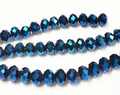 Check out 70 Iridescent Blue Beads 8mm, 6x8mm Faceted Glass Beads , Spacer Bead, Bead Supply, Blue faceted beads, rondelle beads, r19 on vickysjewelrysupply