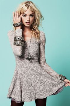 grey dress with silver jewelry