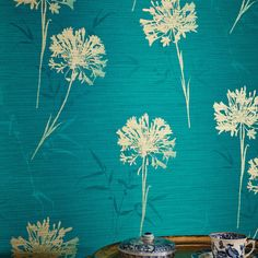 A beautiful floral wallpaper design from Arthouse brought to life in a teal colour scheme. Available at Go Wallpaper UK.