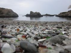 Glass Beach, just outside Fort Bragg in California. Apparently residents used to just chuck their trash over the cliffs into the ocean below. Over the years the glass broke down, and washed back up onto the shore Glass Beach California, California Travel, The Places Youll Go, Places To See, Fort Bragg, Ocean Scenes, Beautiful Places To Visit, Staycation, Mother Nature