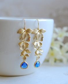 Matte Gold Orchids Cobalt Blue Crystal Glass Drops Earrings. Cobalt Blue Wedding Earrings. These are really beautiful long dangle earrings. They feature