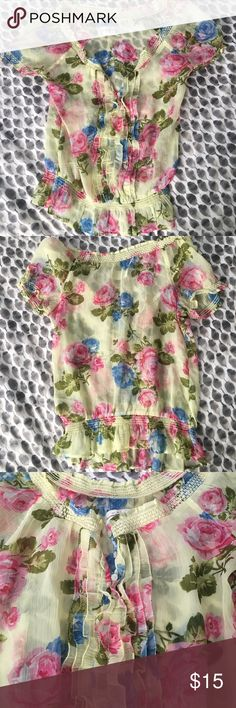 Abercrombie & Fitch floral yellow sheer blouse Adorable yellow floral sheer top.  There is a ruffled front with an elastic waist.  The flowers are pink and blue with green leaves.  Buttons at the top. Abercrombie & Fitch Tops Blouses