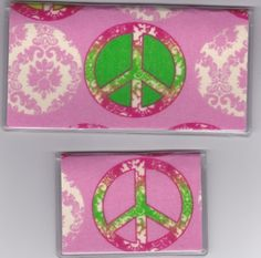 """Hippie Peace Sign Pink Checkbook Cover Set by Tickled Pink Boutique. $9.50. Fun and functional for every day use without paying a designer price for a designer name!  The sturdy clear PLASTIC 12 gauge lightweight VINYL COVER encases a fabric bonded design. Measuring 6 1/4"""" x 3 1/4"""",  the checkbook cover fits all standard bank checkbooks and banking registers.  All checkbook covers come with a register flap and a duplicate check flap just like the bank.    The drive..."""