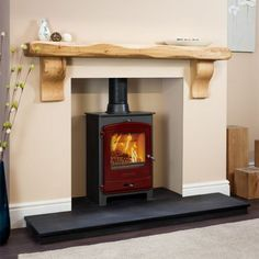 I like the idea of this mantle and hearth(Charnwood C-FOUR on polished granite hearth with oak fireplace beam and painted recess. Fireplace Beam, Fireplace Design, Fireplace Mantels, Fireplaces, Cosy Fireplace, Oak Mantel, Mantel Shelf, Wooden Mantel, Mantle