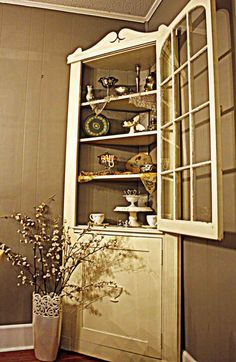 French Country corner cabinets with plenty of space and glass to show-off!