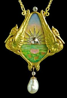 Antoine Bricteux / Art Nouveau Symbolist Pendant / Pendant abundant with symbols for health & luck, particularly for a new mother & child. Two herons, signifying good fortune, encompass lotus flowers floating beneath a brilliant sunrise. The lotus has ancient associations with the origins of life, & dawn is also the triumph of new life after the dark of night.