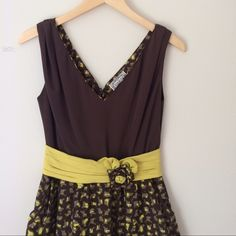Anthropologie brown and mustard dress size 0!! Perfect for fall weddings! Chocolate Brown and mustard colored dress from anthropologie. Only worn twice to weddings and got many complements every time. Size 0. Fitted at waist. Zips up back. Hits mid thigh. Has pockets! Flower at waist is a great detail, not removable. Anthropologie Dresses